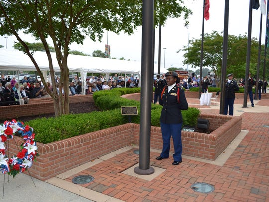 Members of the Wicomico County Jr. ROTC stand at attention during a Memorial Day ceremony at the War Veterans Memorial at the Wicomico Youth & Civic Center on Monday, May 29.