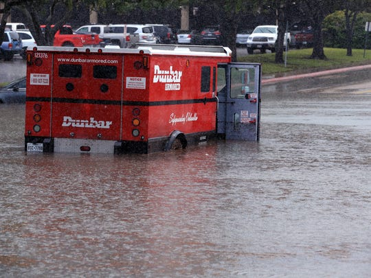 An armored vehicle was caught in flood waters outside the Nueces County Courthouse after a flash flood hit Corpus Christi on Thursday, June 1, 2017.