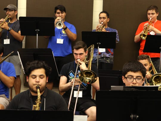 Students participate in the jazz group class during
