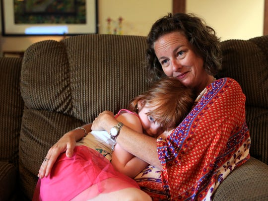 Brandey Batey cuddles with her daughter, Lillian, 4, at their home Tuesday, July 12, 2017. She is involved with the Corpus Christi Maternal Mental Health Coalition, which is looking to stop the stigma of postpartum depression and introduce a peer-to-peer support group to the city.