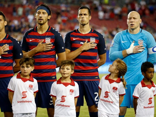 Matt Hedges (center, 21) lined up with the U.S. national team July 12.