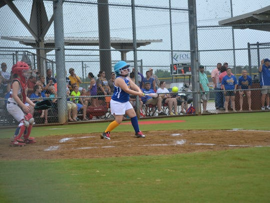 Aubree Deville singles for the local host Sweetees X-Play team from Buckeye Saturday at the Johnny Downs Recreation Complex as part of the Dixie Softball World Series.