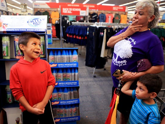 Isaiah Trevino (from left), 10, smiles at his grandmother,