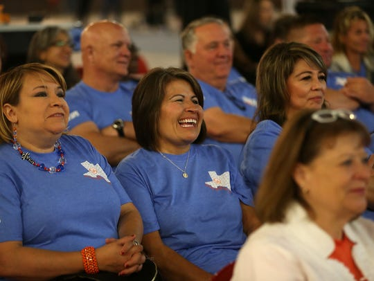 Central High School personnel laugh at a skit performed