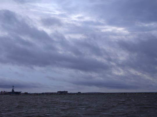 The sky darkens in the Corpus Christi Bay on Aug. 25 as Hurricane Harvey begins to bring rain and winds into Corpus Christi, Texas.