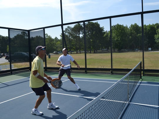 Ocean Pines Platform Tennis Players Association members  Joe Jankowski (left) and Tom Herrick during a summer match.