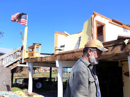 Mike Santana helps work on a friend's damaged home in  Holiday Beach on August 30, 2017. Homes sustained major damage from Hurricane Harvey.