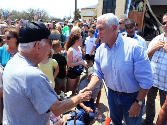 A South Texas resident (left) talks with Vice President Mike Pence in Rockport, TX at the First Baptist Rockport on Thursday, August 31, 2017. Several secretaries of state and the Vice President visited Rockport to reaffirm the federal government's promise of help for victims of Hurricane Harvey.