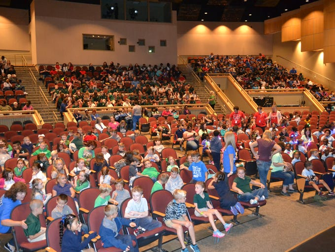Students from area schools fill the auditorium at the