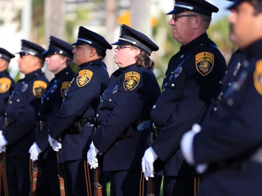 Members of the Corpus Christi Police Department's Color Guard stand at attention during a 9/11 Remembrance Ceremony hosted by city's first responders Monday, Sept. 11, 2017, at Sherrill Park.