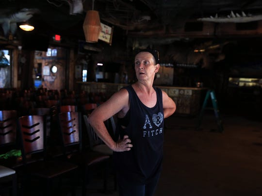 Lynn Mitchell, an employee of Moby Dick's in Port Aransas, TX, surveys completed work on Tuesday, September 12, 2017. Employees and the owners have been cleaning up from Hurricane Harvey since it happened.