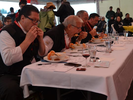 Judges taste a Dungeness mashed potatoes dish with