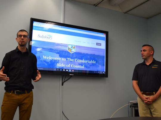 Chris Mcintosh of SBY Digital, left, and Salisbury Mayor Jake Day talk about the new city website on Wednesday, Sept. 20