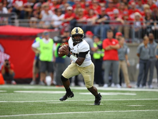 Army quarterback Ahmad Bradshaw looks downfield before a pass.