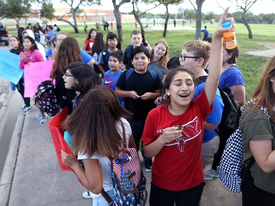 Hamlin Middle School students and some parents protest the removal of the school mascot, the Rebel, on Thursday, Oct. 5, 2017, outside the school.