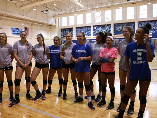 Texas A&M-Corpus Christi Islander volleyball players get an update from their coach on Tuesday, October 10, 2017.