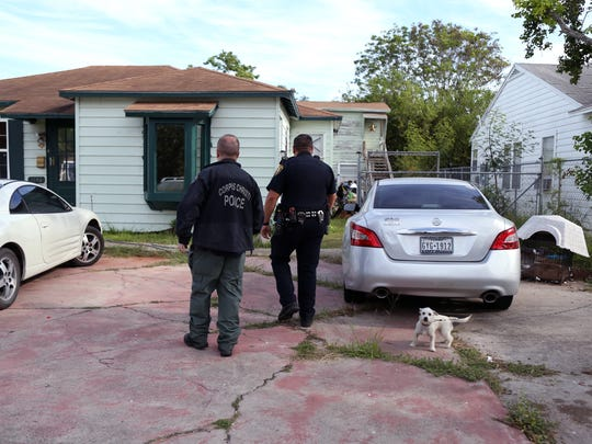 Corpus Christi Police Detective Curtis Volling (left) and Senior Officer Isaac Rodriguez visit a former address for a man they are searching for during a family violence warrant roundup on Thursday, Oct. 19, 2017. The man wasn't at the address, but shortly after the officer left, he contacted Volling on his cell phone.