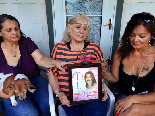 Janie Gatica (from left), Lydia Mu–oz and Nydia Villarreal touch the urn containing the ashes of their sister and daughter, Noemi Villarreal, on Thursday, June 23, 2016. Noemi Villarreal was murdered six days after filing a police report against the man later charged with her murder.
