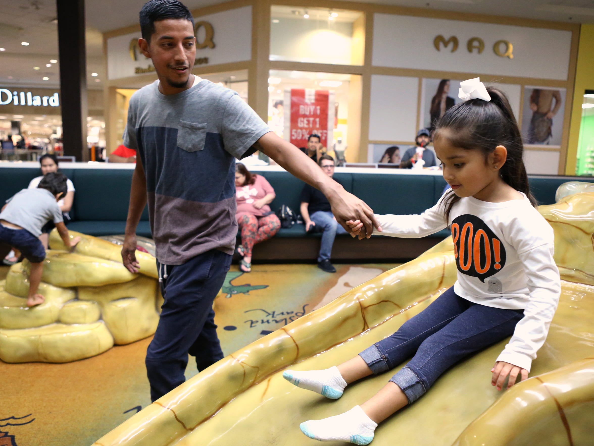 Ezequiel Rojas Martinez plays with Evalynn Rojas, 4 (turns 4 Dec 5) at the play area at La Palmera mall on October 10, 2017. When he isn't working, he spends all the time he can with his girls and wife.