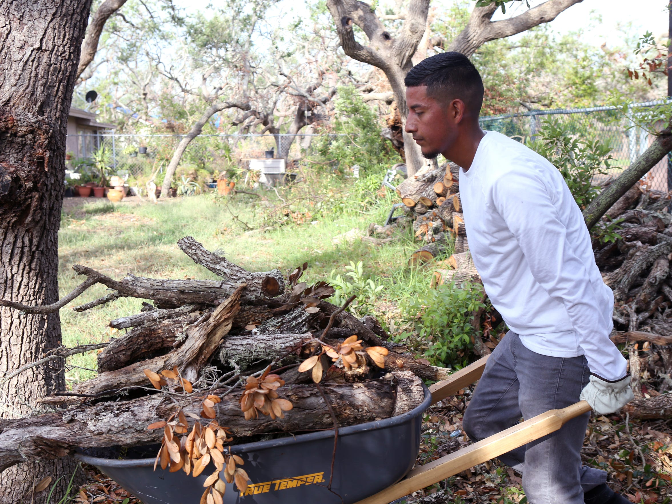 Former DACA recipient Ezequiel Rojas Martinez cleans up debris in Rockport on October 3, 2017. His citizenship status hasn't always made it easy to keep jobs. He's currently seeking legal permanent residency.