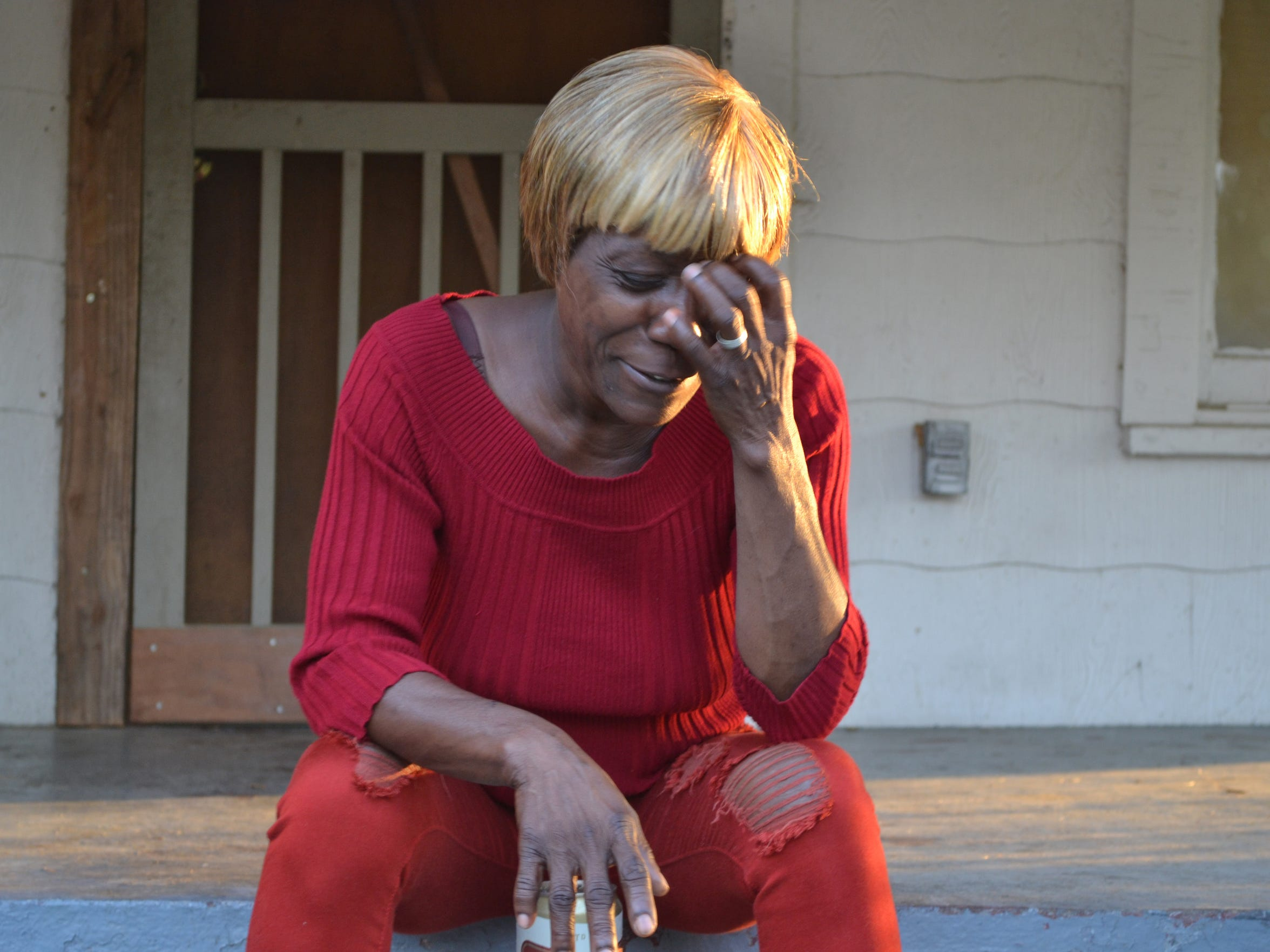 Patricia Aaron sits on the porch of her west Jackson home near the end of the day.