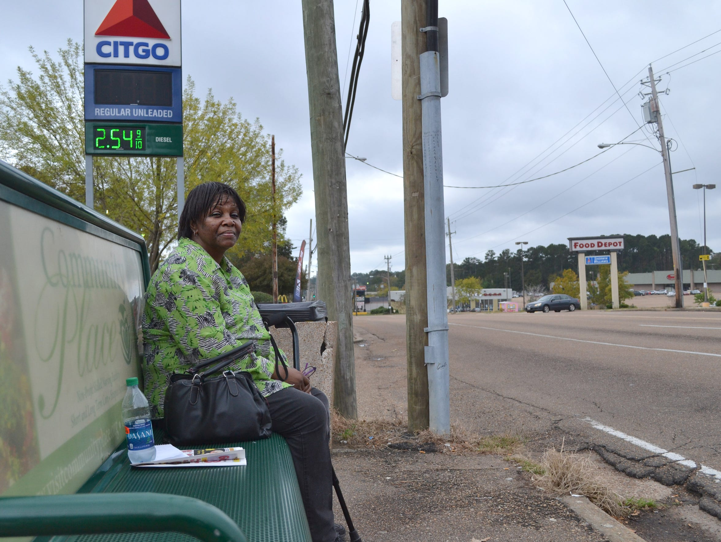 Gladys Bunzy, a JATRAN regular, waits for the bus by the Food Depot in south Jackson. She relies on public transportation for most of her basic needs, like getting to the grocery store.