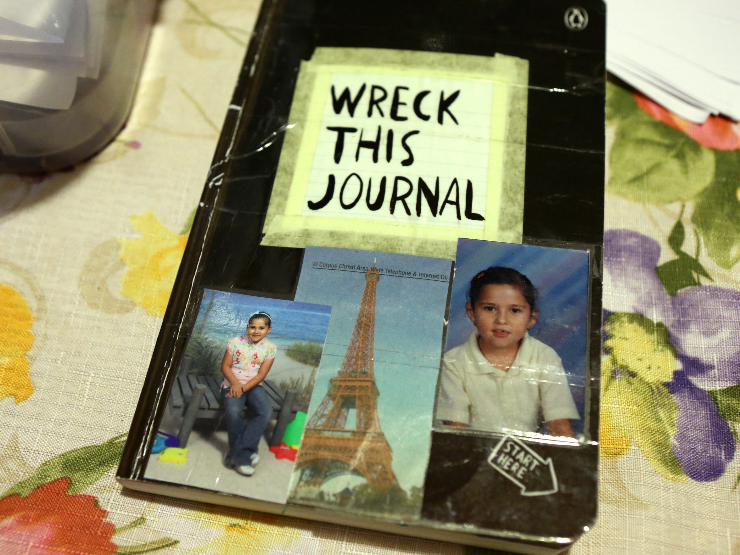 """Very few photos remain of Claudia Jimenez as a small child, these photos line the cover of her journal. Claudia has dreams of someday going to Paris, but knows she can't without """"papers."""""""