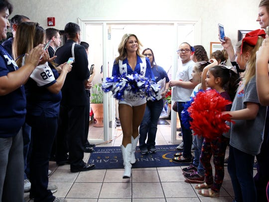 Dallas Cowboy cheerleader Lauren prepares to sign autographs at Trisun Care Center Coastal Palms in Portland on Wednesday, Dec. 20, 2017.