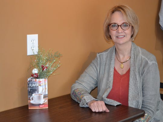 Tomi Johnson has sold real estate for 38 years and opened Victory Coffee & Company inside her Marblehead Howard Hanna real estate office in 2012.