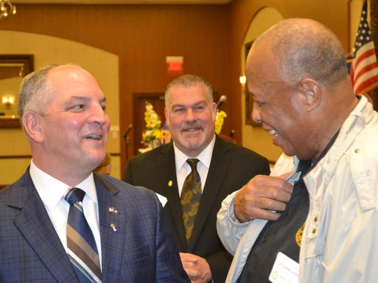 Governor John Bel Edwards (left) talks with Avoyelles Parish Police Jury President Charles Jones (right) as Avoyelles Rotary Club President Van Roy looks on after addressing a combined meeting of the Rotary Clubs of Avoyelles, Lecompte and Bunkie Monday at the Paragon Casino and Resort in Marksville.
