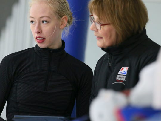 Olympic figure skater Bradie Tennell, left, speaks with her coach, Denise Myers, during practice at the Twin Rinks Ice Pavilion in Buffalo Grove, Ill., on Jan. 29.