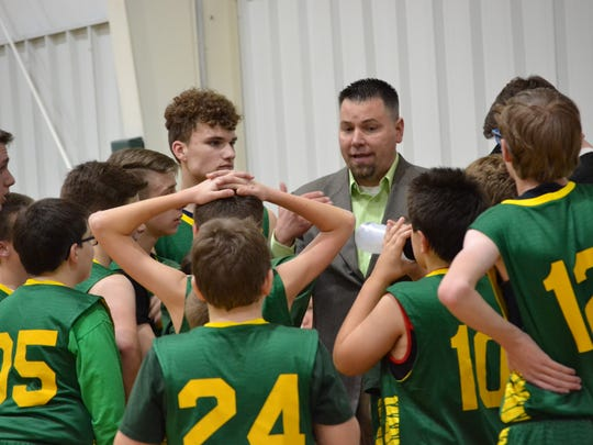David Weirich coaches his players during a time-out