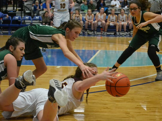 Grace's Maggie Creamer (1) reaches for a loose ball from Claiborne's Kaylon Cory (15). Grace fell to Claiborne Christian 41-39 in semifinal action of the 2018 State Girls' Basketball Championship Monday at the Rapides Parish Coliseum.