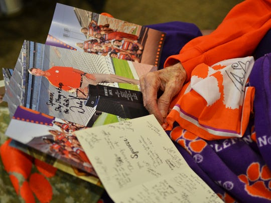 Spencer Glenn, 83, received signed photos and cards from the Clemson Football team on Friday March 2, 2018. Glenn has Parkinson's and Alzheimer's, and the director of his hospice care team organized a Clemson-themed party for him just to lift his spirits.
