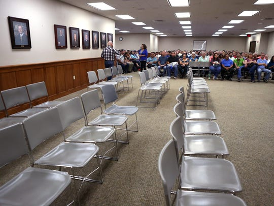 Jurors attend jury duty in October, a year after the Nueces County Courthouse instituted online jury impanelment. Prior to the system, the room was filled to capacity, with potential jurors lining the walls.