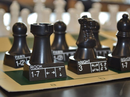 The Woodmore Chess Club owns several chess sets as