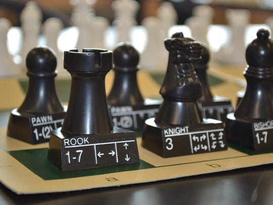 The Woodmore Chess Club owns several chess sets as well as these practice pieces that show how the pieces can move. The club includes students from 2nd through 8th grade, many of whom have played chess for years.