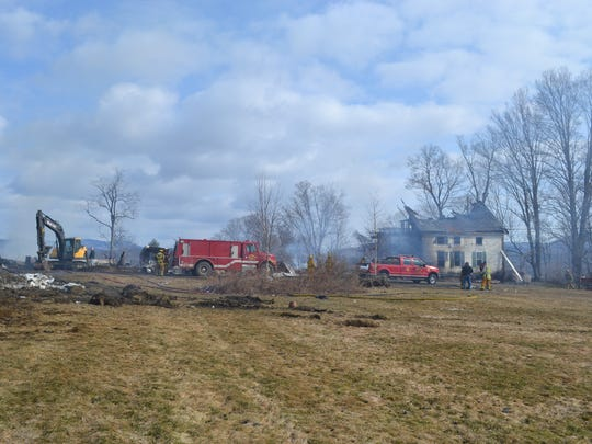 Smoke lingers after a fire destroyed a barn and two