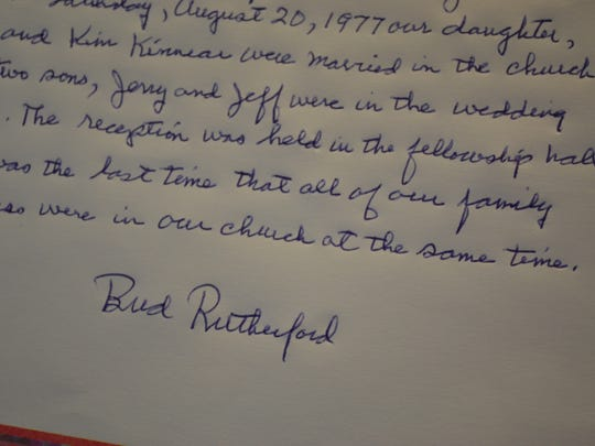 Longtime member Bud Rutherford shares one of several memories in the church's memory book that has been created to commemorate its 125th anniversary.
