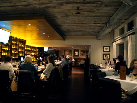 The bar area with tables for dining at Southern Social