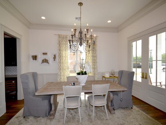 The formal dining area has views of the outdoors.