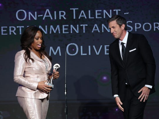 FAMU's Pam Oliver receives Gracie Award from fellow Fox colleague, Kevin Burkhardt.