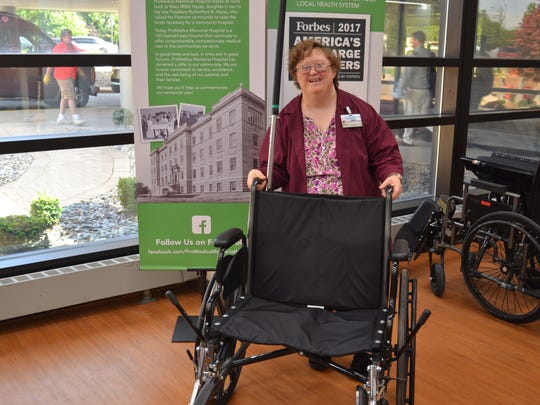As part of her duties as a Hospital Ambassador, Mary Jo Miller greets visitors at the hospital's front entrance and takes them by wheelchair or foot to their destinations.