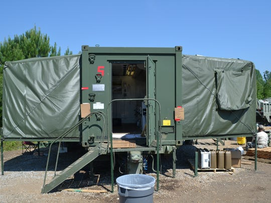Containerized kitchens, or CKs, are designed like 18-wheeler trailers with sides that can slide out. Each CK can provide up to 3 meals per day for 800 soldiers.
