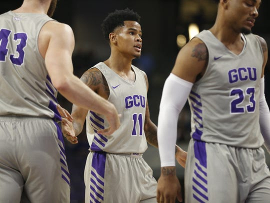 GCU's Damari Milstead (11) high-fives teammates after