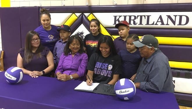Kirtland Central's Nia Nelson signs her national letter of intent on Wednesday to continue her volleyball career at Haskell Indian Nations University.