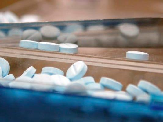 Pharmacist Eric Russo dispenses Percoset at Hobbs Phamacy in Merritt Island.