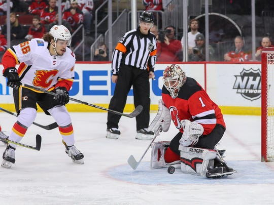 New Jersey Devils goaltender Keith Kinkaid (1) makes a save on Calgary Flames left wing Ryan Lomberg (56) during the first period at Prudential Center.