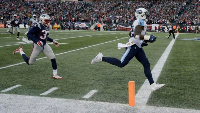 Titans tight end Delanie Walker crosses the goal line for a 57-yard touchdown ahead of Patriots defensive back Jordan Richards (37) in the second half.