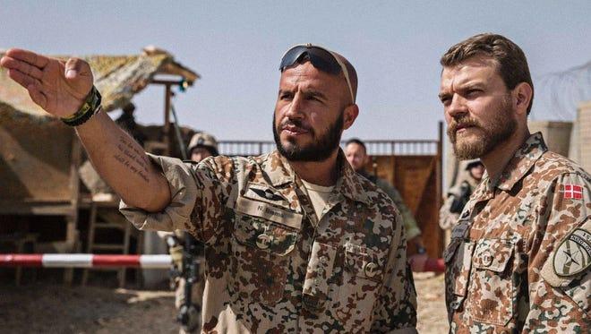 "Dar Salim (left) and Pilou Asbaek star as soldiers stationed in Afghanistan in ""A War."""